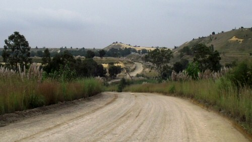 Dirt road between the mine dumps. Johannesburg, South Africa